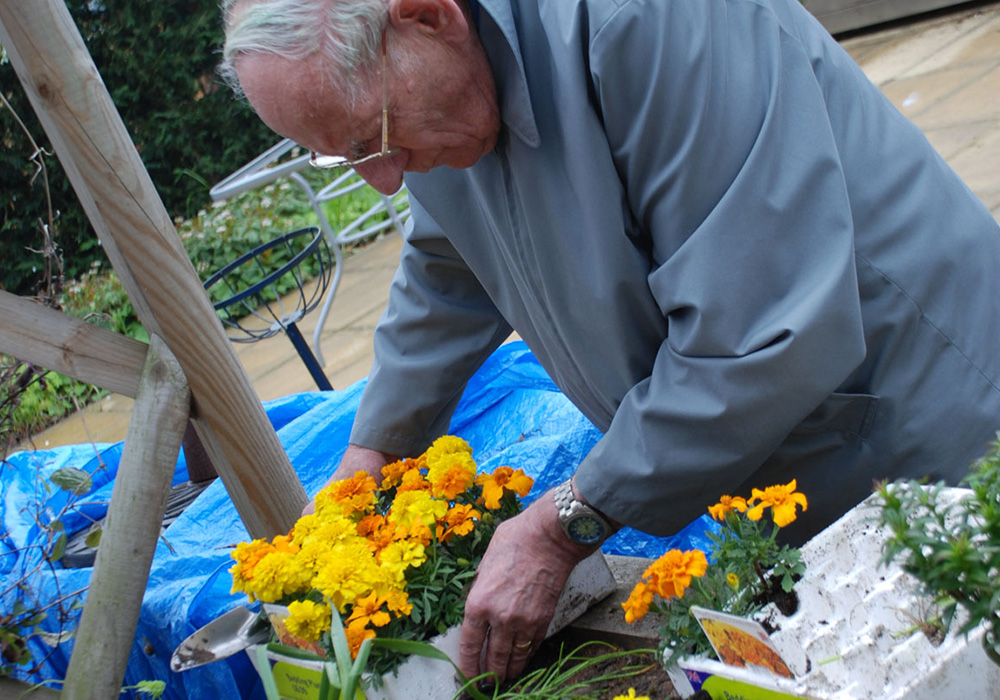The residents spent the afternoon lovingly planting spring blooms.