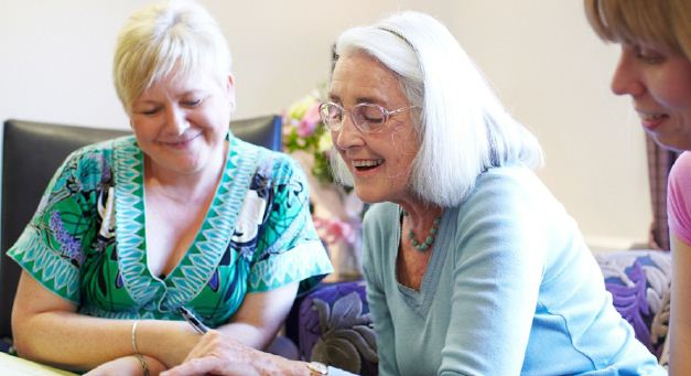 An Acorn Court resident reads with a staff member